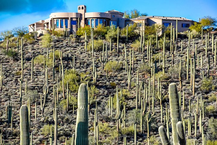 This residence is surrounded by an astonishing amount of mature saguaros and spectacular desert and mountain scenery!