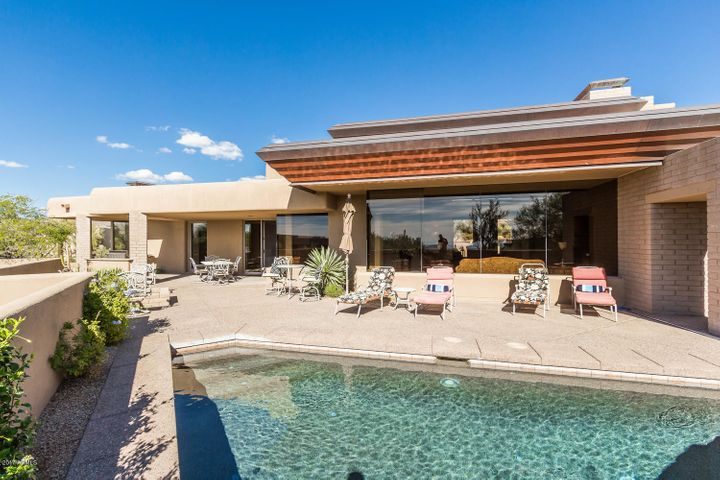 Relaxing covered patio with Resort Style Backyard