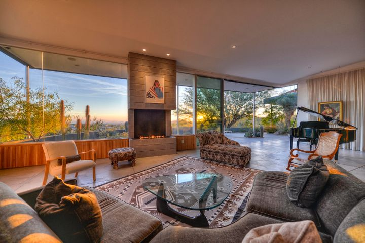 Amazing living space with invisible walls that open up to a large patio and incredible panoramic views!