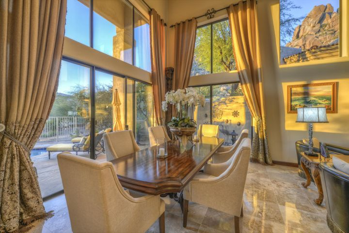 Ceiling height 20 feet with walls of glass, bringing the outdoors inside.