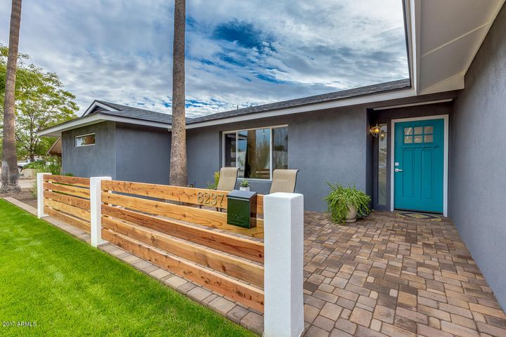 Paved walkway and patio with custom redwood fence. Buyer can choose paint palette and seller will accommodate.