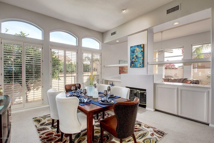 Wall of Windows! Formal Dining Area with two sided Fireplace!