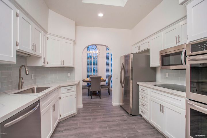 Welcome to your newly remodeled home. New flooring, quartz counters, new appliances, paint and lighting.