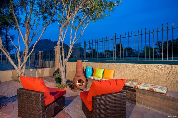 Beautiful views of Camelback Mountain and Phoenician Golf Course. Privacy of a corner lot, three patio areas and only one neighbor. North and South exposure!