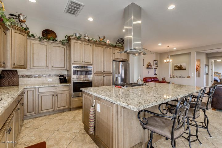 Beautifully appointed kitchen with granite slab counters, upgraded cabinetry, stainless steel appliances.