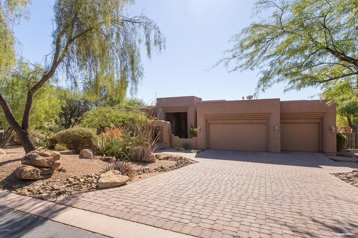 Brick Driveway and lush Desert landscaping