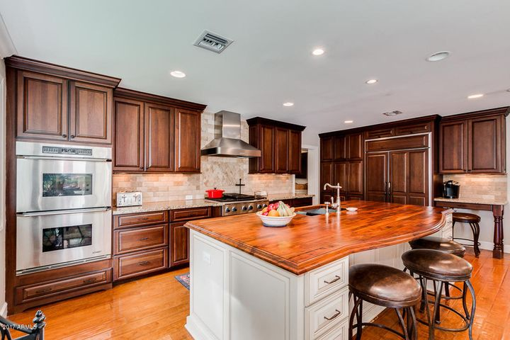 6 Burner Gas Stove, Double Oven, Oversized, Built-in GE Side by Side, Monogram Refrigerator.