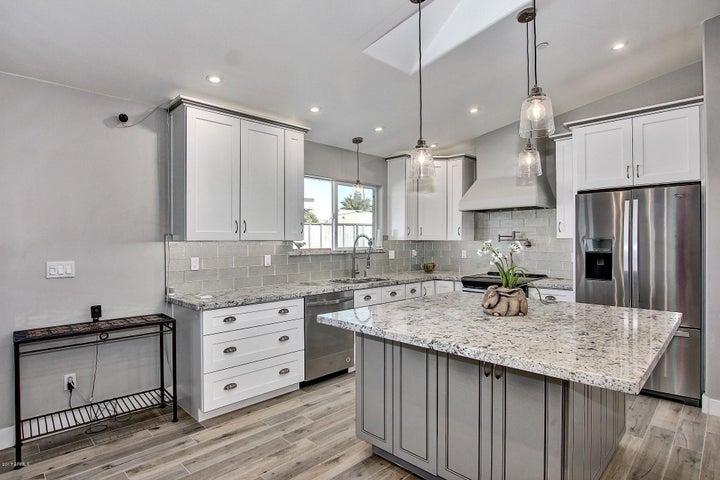 Shaker style soft-close cabinets, large island, and beautiful granite.