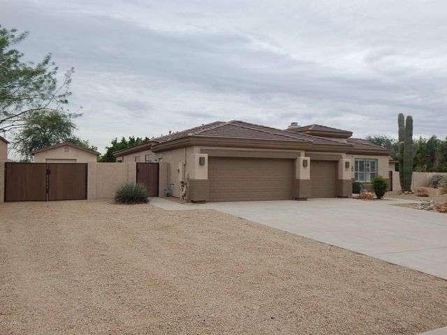 Situated on almost 1/2 Acre Lot with RV Garage!