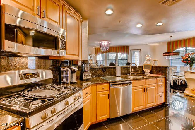 Granite counters and Black Granite floors. SS appliances. Lots of room for preparation for entertaining guests.
