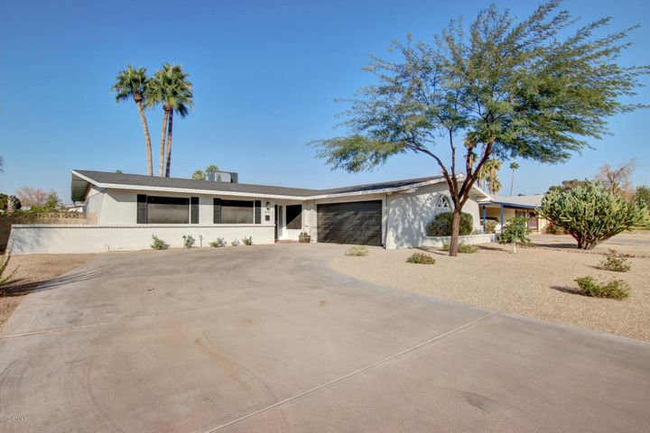 Beautiful remodeled three bedroom with a pebbletech pool