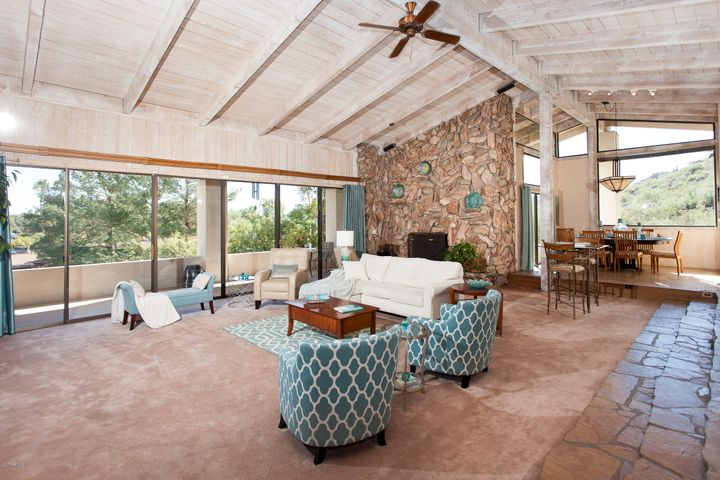 Huge great room with beautiful real wood beams and ceiling