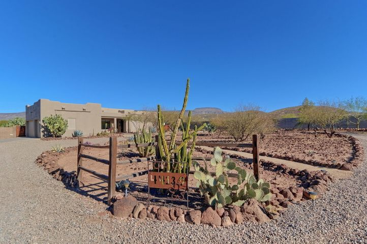 Natural beautiful landscaped entry, circle drive to home