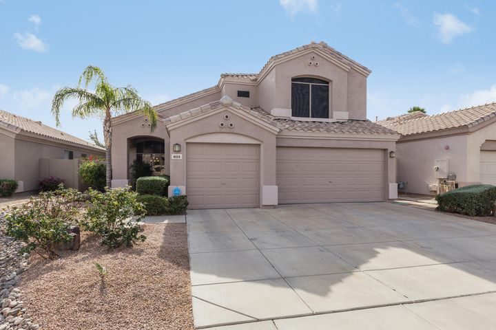 Recently painted exterior and low maintenance desert landscape in the front yard provide a very welcoming curb appeal.