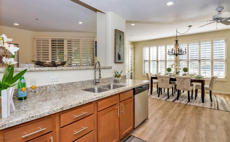 kitchen open to dining room facing golf course