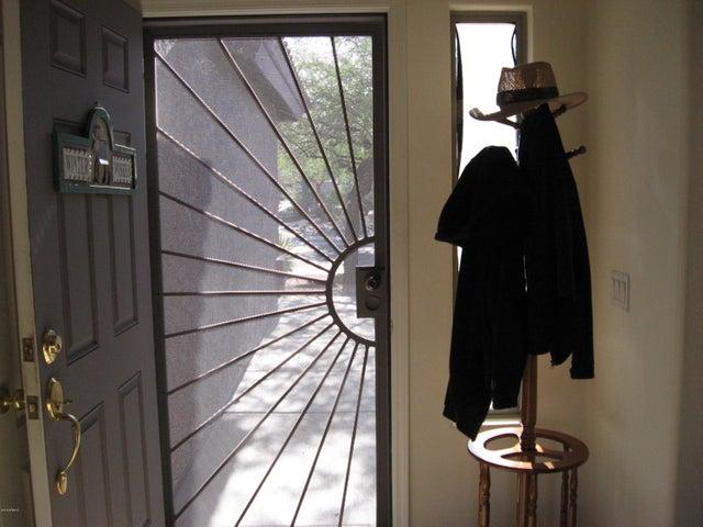 Front door has a very nice security door.