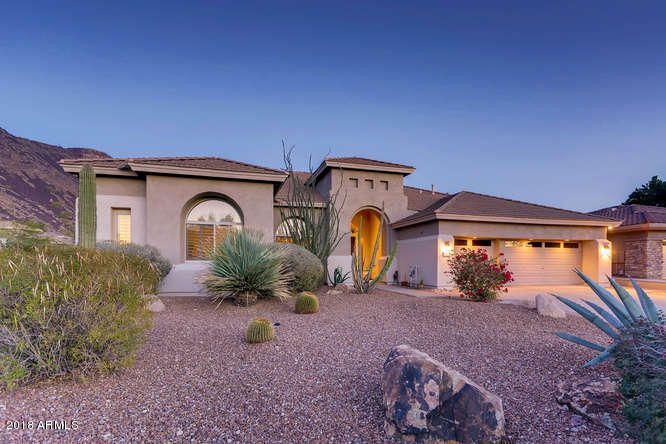 Spectacular semi-custom home in the niche neighborhood of Carino Canyon .