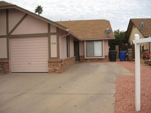 Front of unit facing south. Showing garage
