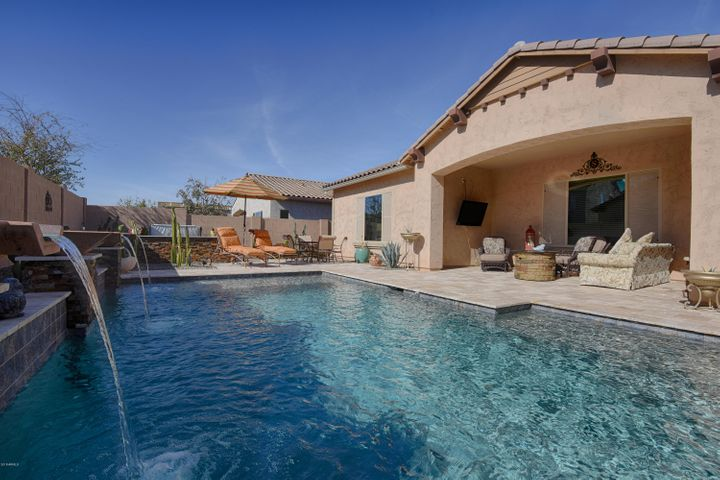 Desirable Sunny Southern Back Yard has a Large Pool, Above Ground Spa, Fire Pit with easy maintenance Desert Landscaping