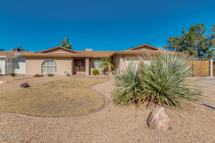 This home sits on a corner lot with pool, RV gate and parking