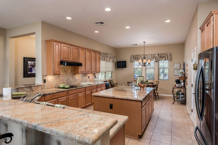 Beautiful Granite, Island and Maple Cabinetry