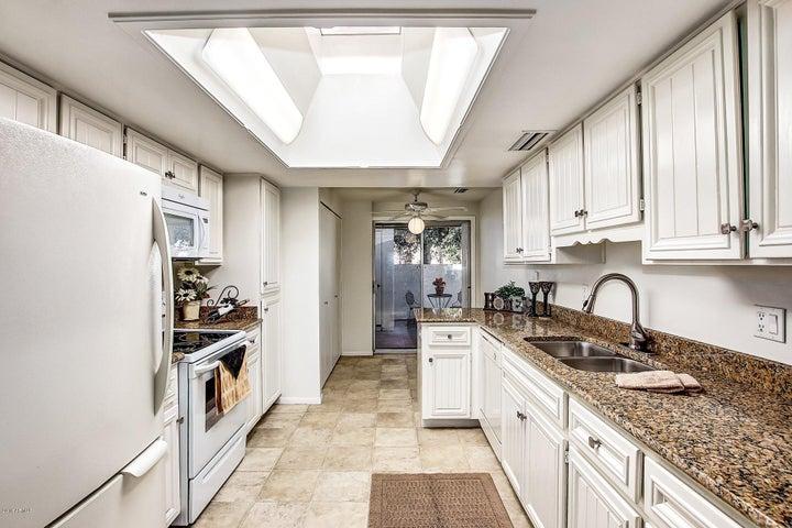 Light bright kitchen. New granite counters.