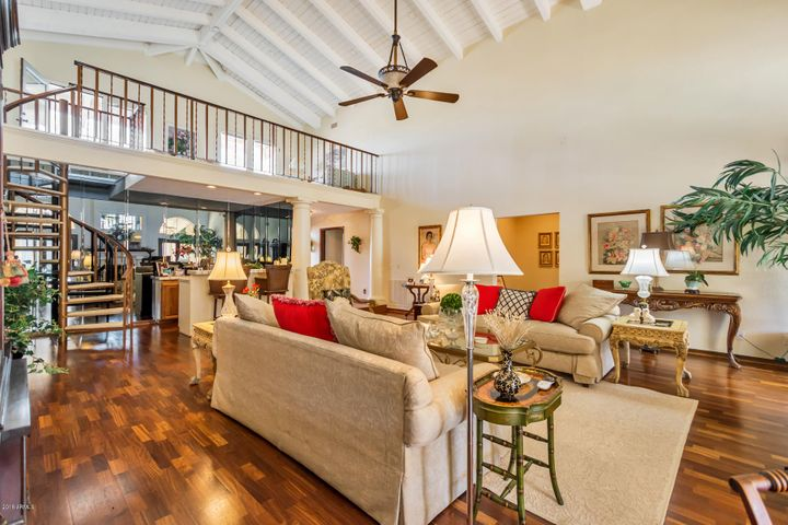 Large, two-story great room with bar and loft