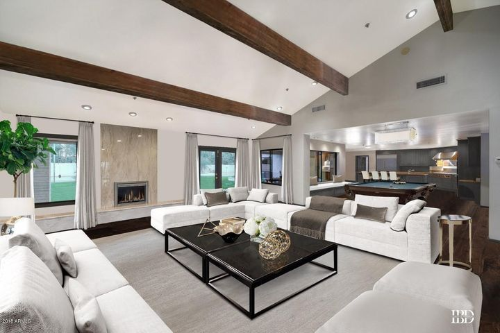 Family Room, Billards and Gourmet Kitchen overlook this lush acreage of grass, sports court, pool and playground (Staged Family Room)