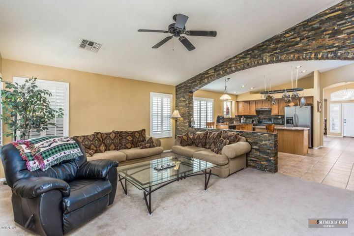 The family room is spacious with vaulted ceilings.