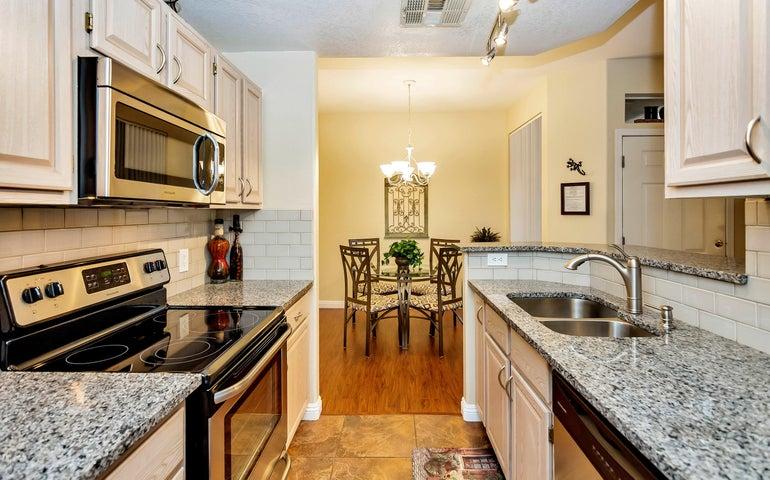 Stainless Appliances, new granite and backsplash