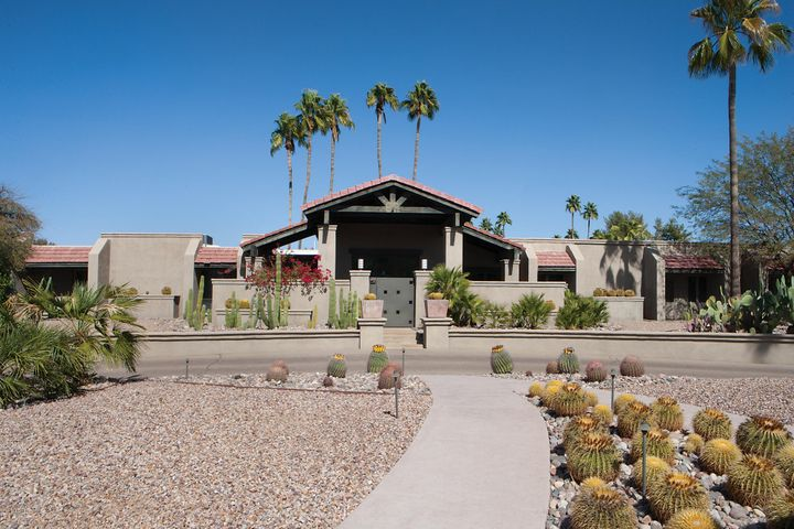 N/S exposure and circular driveway leads to private gated courtyard entry.
