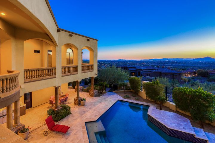 One of the most desirable lots in Ancala Country Club features phenomenal city light views.