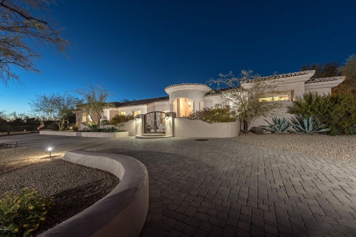 ...tucked on a privately gated cul de sac, 2 acre estate