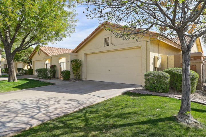 Tree Lined Streets & Lush Green Lawns Welcome You Home !
