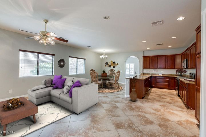 virtually staged kitchen and great room from hallway
