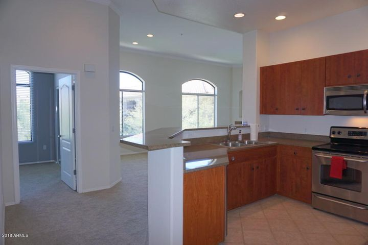 This corner unit has walls of windows & soaring ceilings.