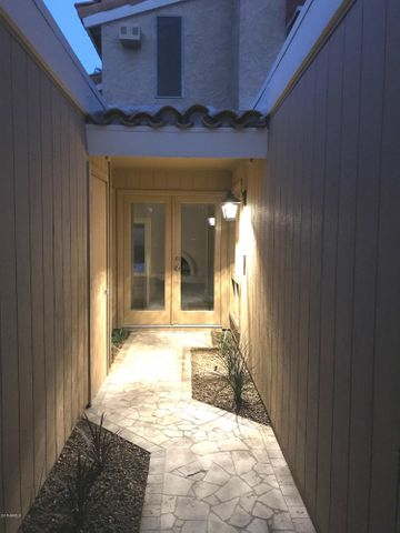 Private courtyard entrance tiled entry.