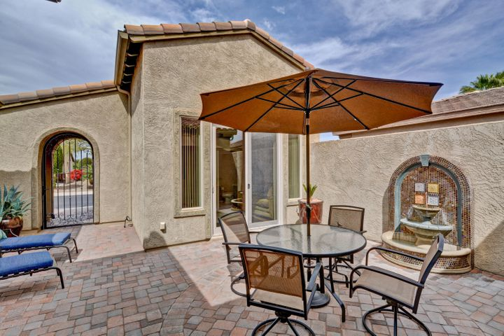 Enter the arched gate to a beautifully pavered courtyard with soothing fountain. The casita entrance has sliding doors.