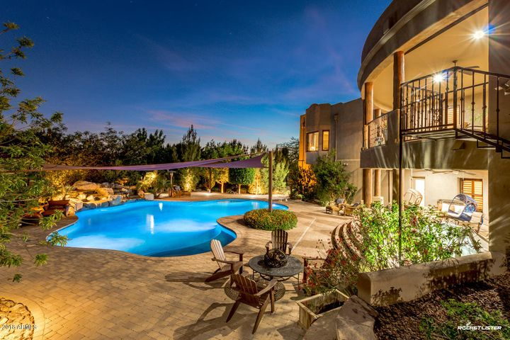 Welcome to this beautiful custom home located next to Thunderbird Mountain