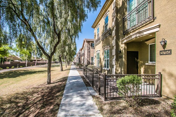 Charming courtyard entry is gated & overlooks a greenbelt.