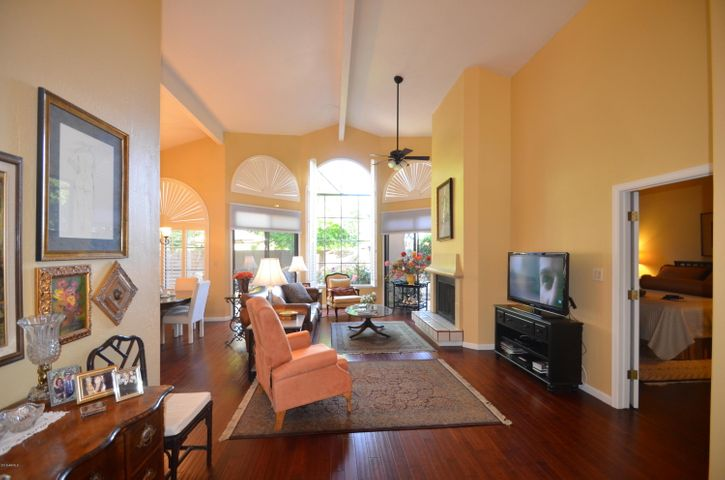 great room with vaulted ceilings and custom shutters