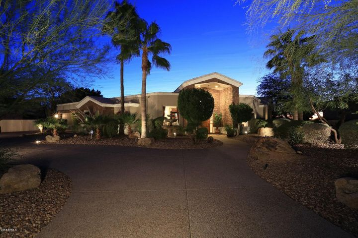 professionally landscaped with circular drive and additional parking pad
