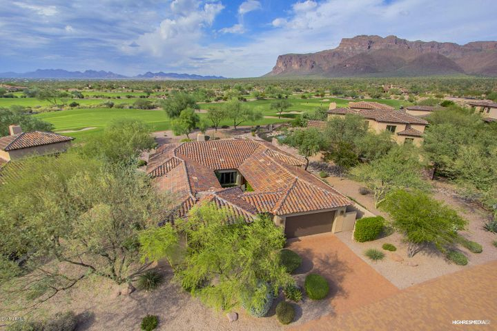 Views of Superstition Mountain and multiple fairways of Prospector Golf Course