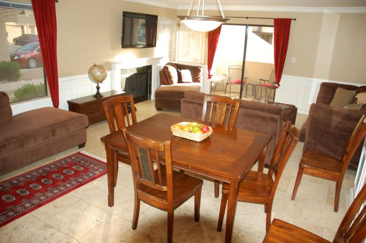 Main large living space with large windows that make it bright and happy. Covered Patio.