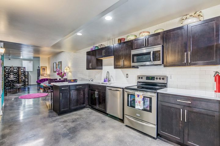 Inside the front door you will find an AMAZING kitchen with Quartz counters, stainless steel appliances and a great room