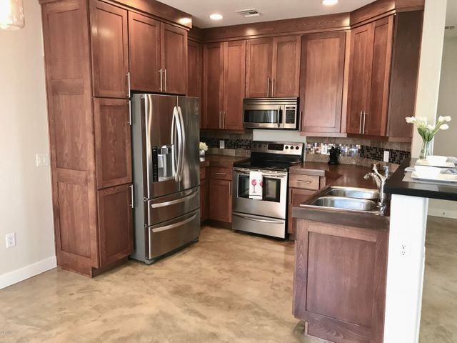 Kitchen with granite countertops and SS appliances.