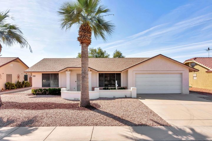 Great Curb Appeal with large Pine Apple Palm.