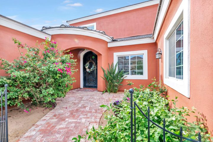 Walk up the brick pathway to the rounded entry way. This area could easily be gated if you wanted a private front courtyard.