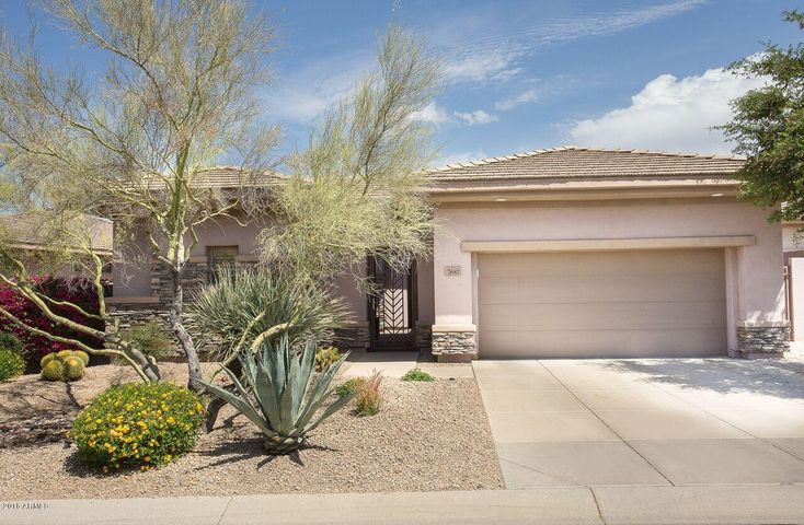Lovely curb appeal with security gate to courtyard
