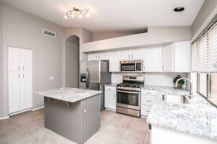New granite countertops, new appliances, new backsplash & updated cabinets.